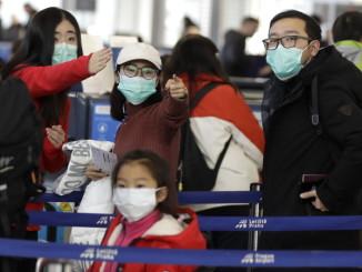 Американські банки і фірми радять співробітникам уникати поїздок до Китаю